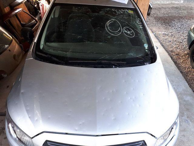 Capô original onix/prisma 16/17/18 com avarias de chuva de pedra