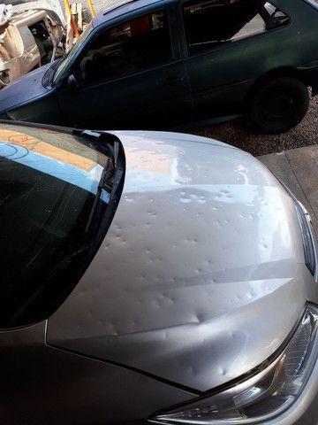 Capô original onix/prisma 16/17/18 com avarias de chuva de pedra  - Foto 2