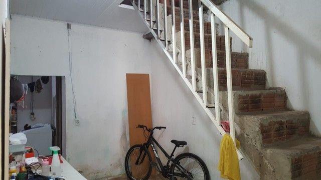 Vendo casa de primeiro andar