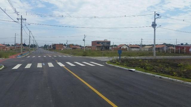 Terreno com pequena entrada, loteamento todo asfaltado - Foto 8