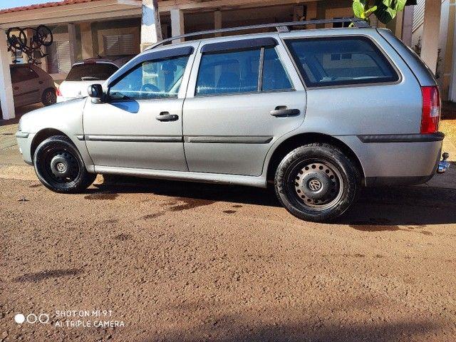 Jogo rodas 14, 4x100 original VW (família Gol) com calotas Amarok, 4 bicos sem pneus. - Foto 3