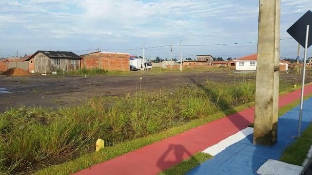Terreno com pequena entrada, loteamento todo asfaltado - Foto 5