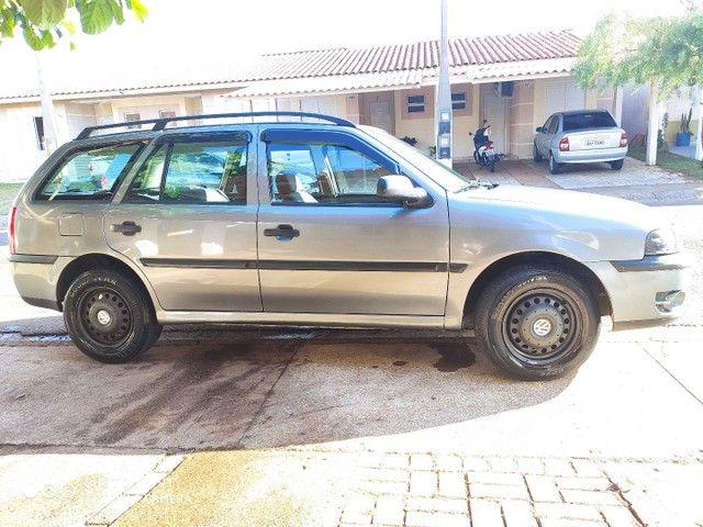 Jogo rodas 14, 4x100 original VW (família Gol) com calotas Amarok, 4 bicos sem pneus. - Foto 2