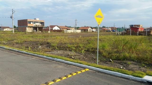 Terreno com pequena entrada, loteamento todo asfaltado - Foto 6