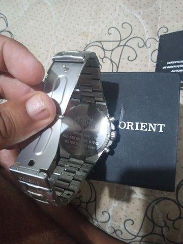 Vendo relógio orient R$- 700.00  - Foto 6