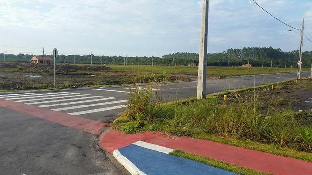 Terreno com pequena entrada, loteamento todo asfaltado - Foto 4