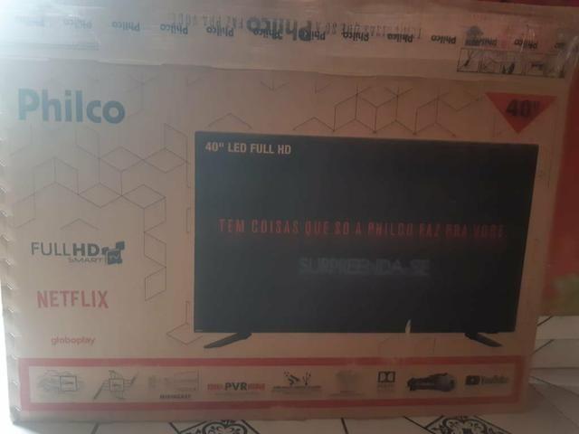 "Smart tv 40"" semi novo. 2 meses de uso"