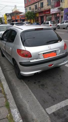 Peugeot top 2004 12mil leia