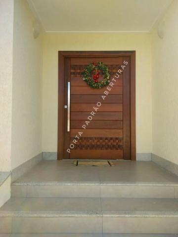 Porta pivotante de madeira maciça para Lages - Foto 2