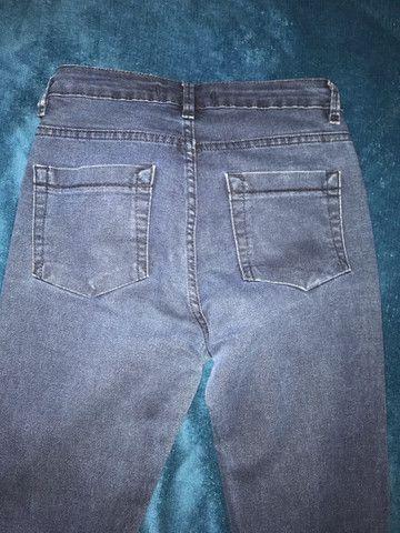 Calça jeans boca de sino tamanho 36 - Foto 3