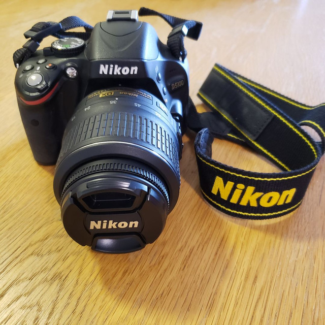 Nikon D5100 com bolsa mais lente extra - Foto 5