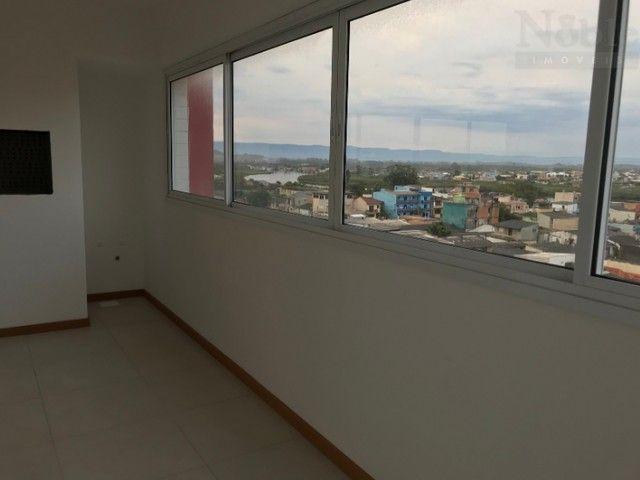 Apartamento de 3 dormitórios com suíte no Centro - Foto 4