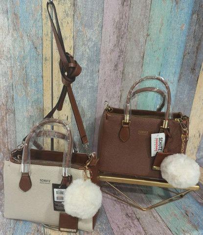 Vendo bolsas femininas por apenas r$ 149 vários modelos várias marcas - Foto 2