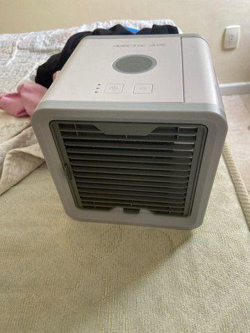 Mini ar condicionado  a base de água