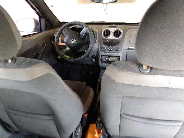 Chevrolet Agile LTZ 1.4 2011 GNV Vermelho - Foto 10