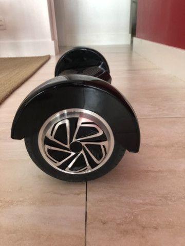Hoverboard preto c/Bluetooth som e luzes - Foto 4