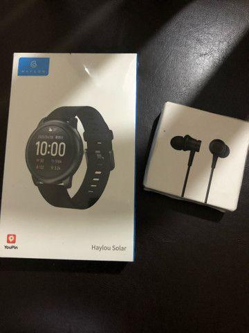 Relógio  + fone de celular ( novo na caixa )