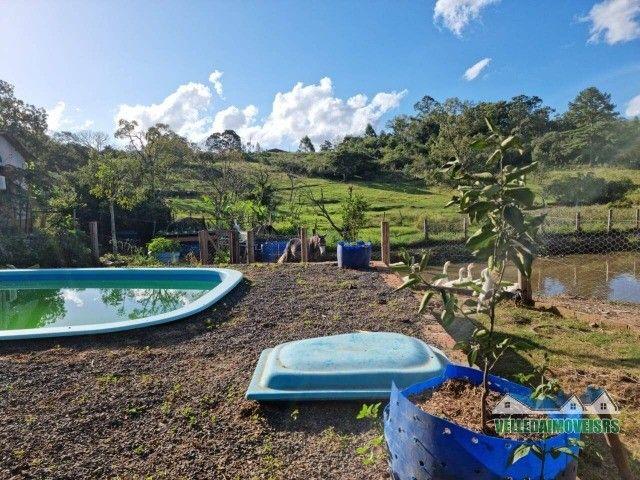 Velleda oferece 1 hectare a 5 minutos centro viamão com açude e casa, troca - Foto 16