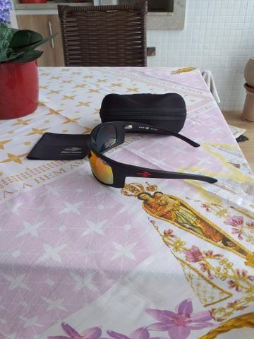 Vendo lindo oculos de sol Mormaii Acqua produto novo e original completo - Foto 2