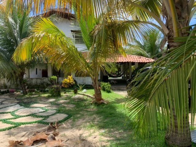 Casa duplex para venda tem 146m2 com 4 suítes próximo a praia da Caponga - Cascavel - CE - Foto 11