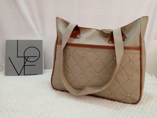 Bolsas femininas vários modelos  - Foto 4