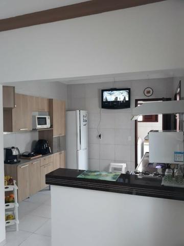 Casa 03 dorm, sendo 02 suite, 02 salas, garagem 04 autos, terreno de 250 mts. (financia)