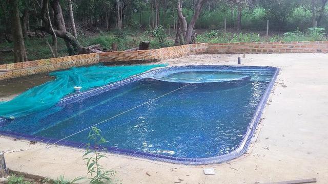 Chacaras parcelada com casa e piscina