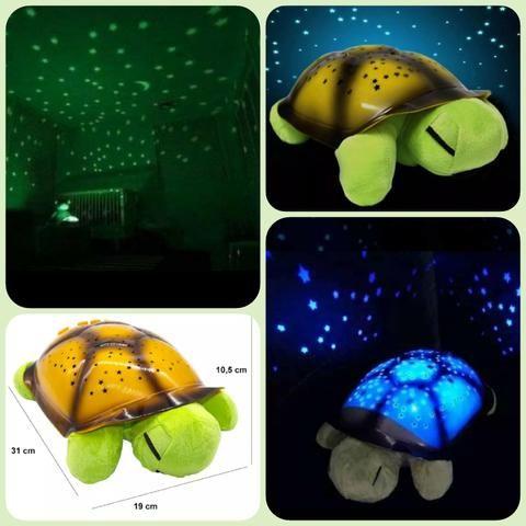 Luminária infantil musical projeta céu ESTRELADO