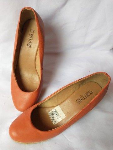 Sapato cor claro conforme foto