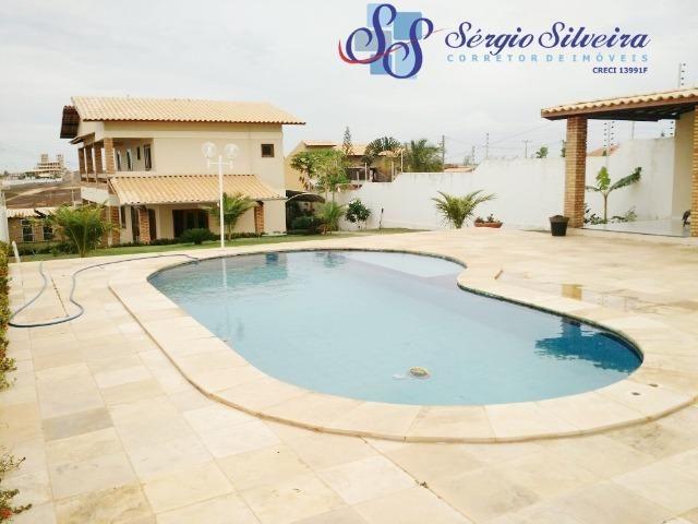 Casa no Porto das Dunas com piscina e churrasqueira duplex com amplo terreno