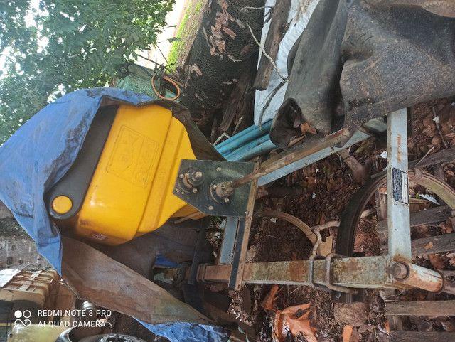 Cultivador rancador ou afogador de mandioca e  batedor de ramas