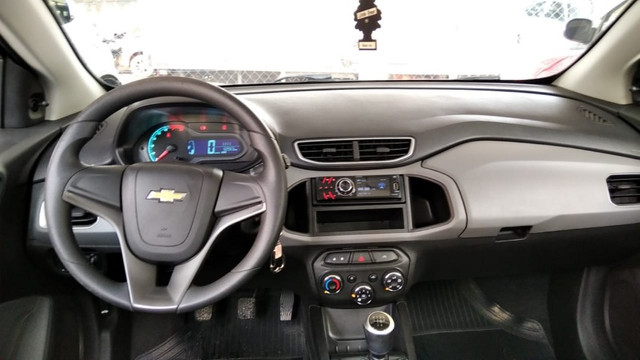 Onix Hatch LT 1.0 8V Flexpower - Foto 8