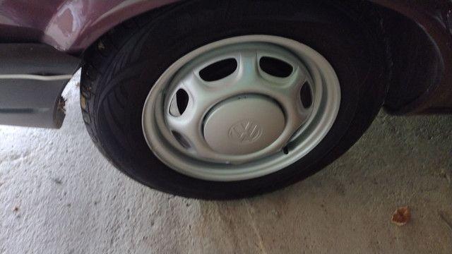 Vendo ou troco lindas rodas 13 coquinho por 15 com pneus  - Foto 4