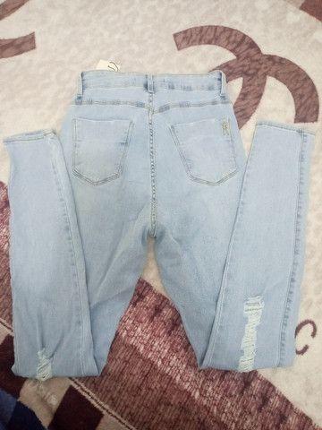 Calça jeans da miller 42 - Foto 2