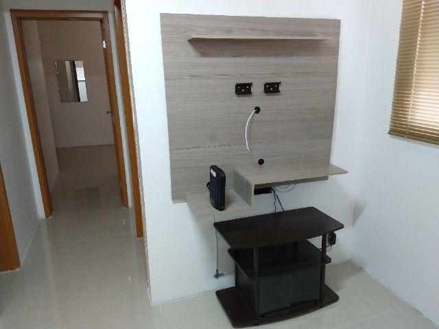 Vendo apartamento semimobiliado térreo 2 quartos - Foto 14