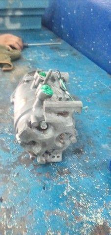 Vendo ou troco em rodao 15 compressor o honda  - Foto 4