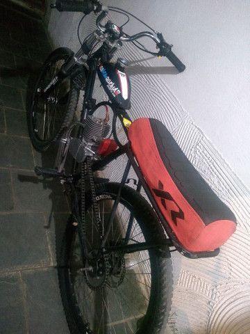 Vendo ou troco motorizada 100cc, com nota.