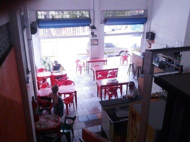 Vendo/alugo loja de esquina com amplo mezanino no centro de São Vicente/SP