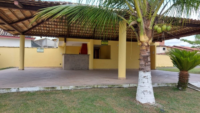 Casa de 3 quartos com suite em condomínio com lavabo, garagem para 4 carros e quintal - Foto 18