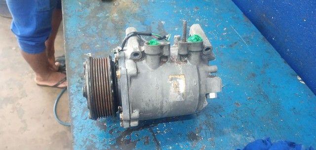 Vendo ou troco em rodao 15 compressor o honda  - Foto 3