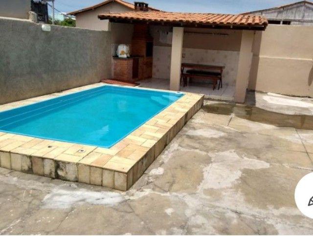 Casa com piscina em ótima localização