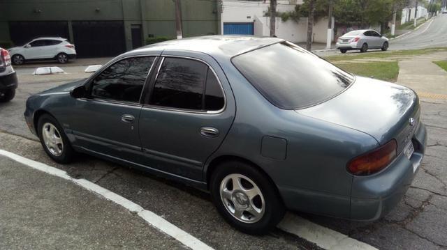 Nissan Altima 1993 2.4 16v - Foto 9
