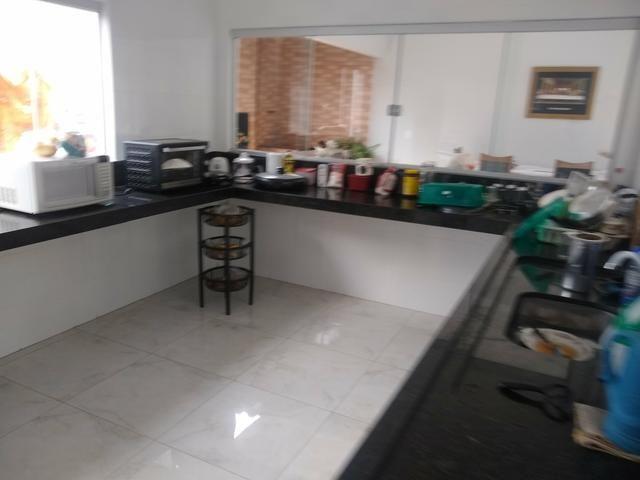 Casa em caldas 4 dormitórios,toda na laje, área de churrasco,bem localizada - Foto 3