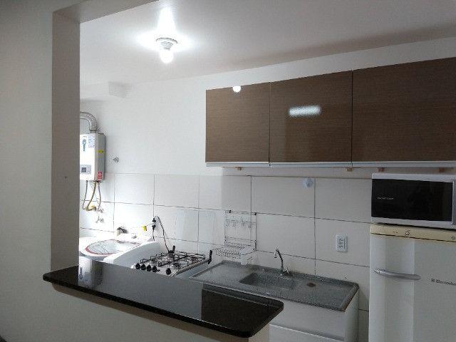 Vendo apartamento semimobiliado térreo 2 quartos - Foto 5