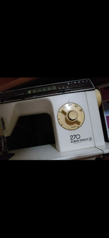 máquina de costura singer portátil