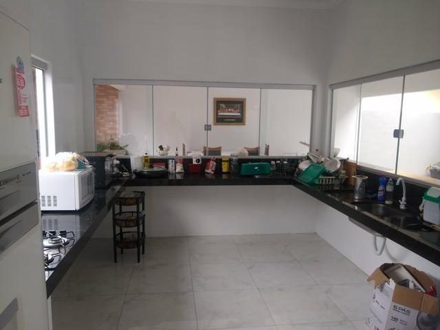 Casa em caldas 4 dormitórios,toda na laje, área de churrasco,bem localizada - Foto 4