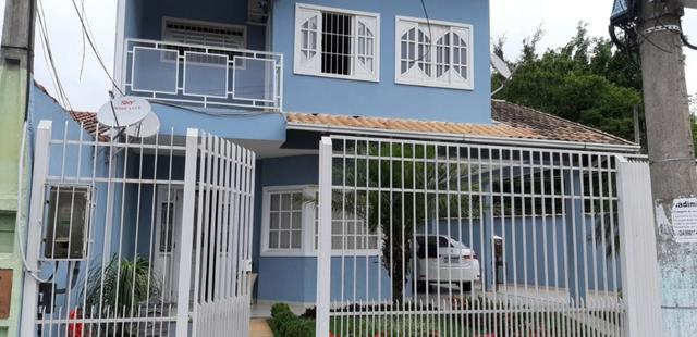 Linda casa de esquina no bairro Vila Rica - Foto 2