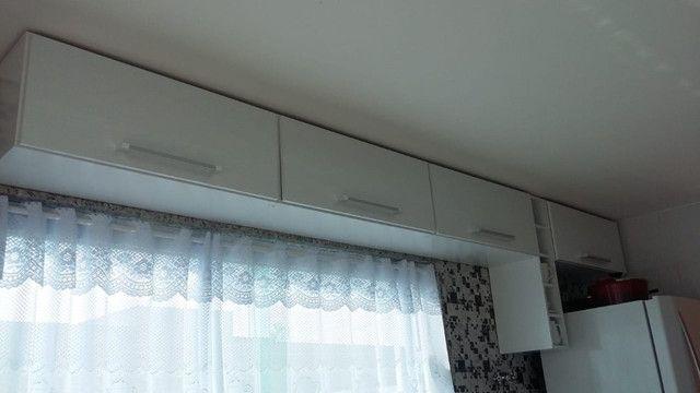 Casa de 3 quartos com suite em condomínio com lavabo, garagem para 4 carros e quintal - Foto 13