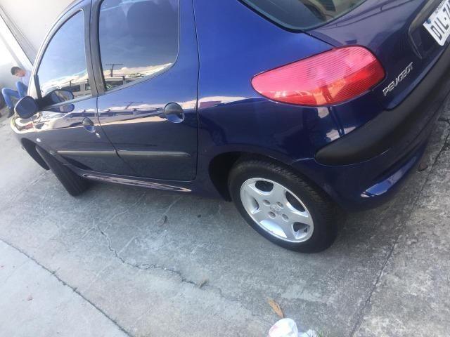peugeot 206 troco por carro financiado - 2001