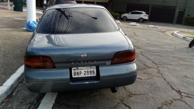 Nissan Altima 1993 2.4 16v - Foto 7